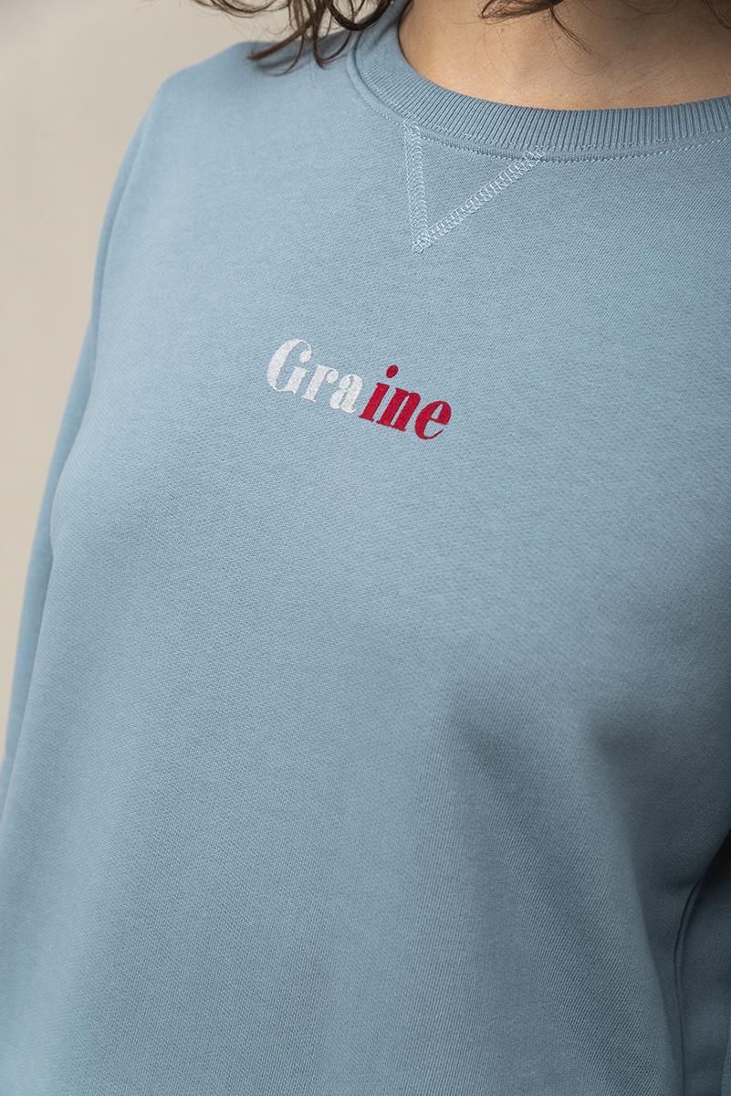 Sudadera color azul de cuello redondo y manga larga con estampado gráfico, 100% algodón orgánico